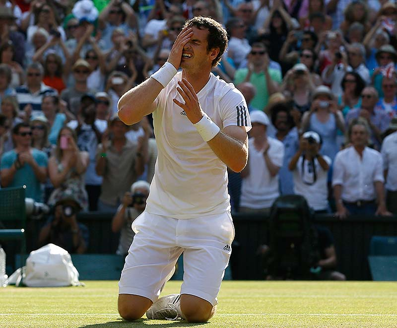 Andy Murray reacts after beating Novak Djokovic for the men's Wimbledon championship Sunday in London. Murray became the first British man to win the title in 77 years.