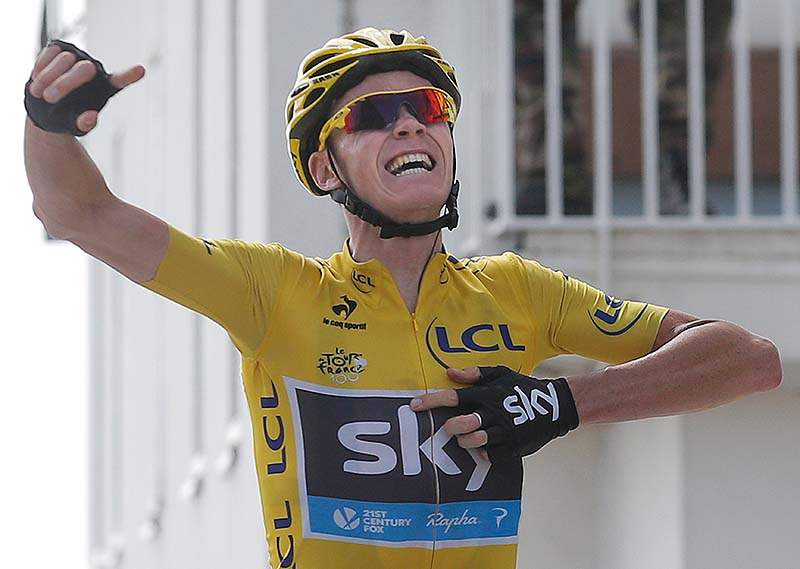 Overall leader Christopher Froome celebrates as he crosses the finish line of the 15th stage of the Tour de France on Sunday.