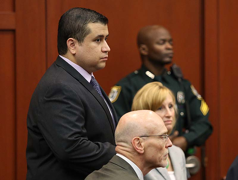 George Zimmerman stands with his defense attorneys during the continuation of jury deliberation in his trial in Seminole circuit court in Sanford, Fla. on Saturday. Zimmerman has been charged with second-degree murder for the 2012 shooting death of Trayvon Martin.