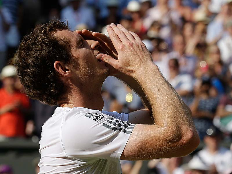 Murray reacts after defeating Novak Djokovic in straight sets for the men's title at Wimbledon on Sunday.