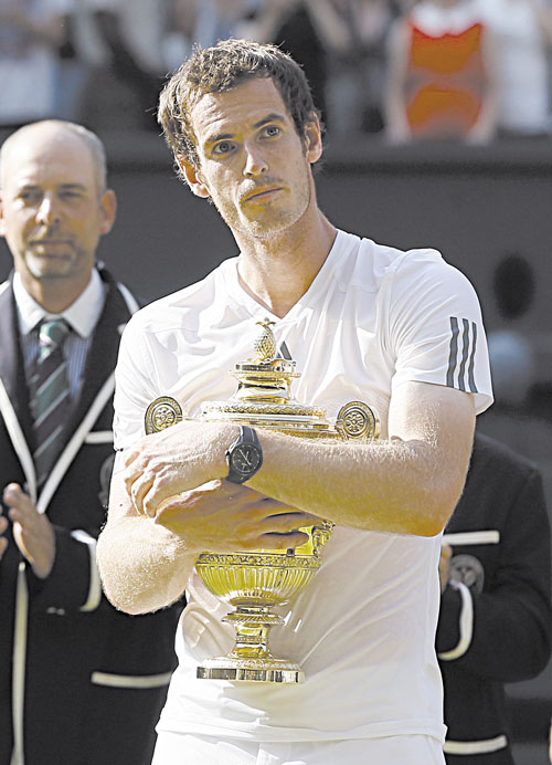 CLOSE TO THE HEART: Andy Murray holds the trophy after defeating Novak Djokovic for the Wimbledon title Sunday in Wimbledon, London.