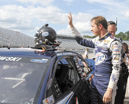 THANK YOU, THANK YOU: Brad Keselowski waves to fans Friday after winning the pole during qualifying for Sunday's NASCAR Sprint Cup race in Loudon, N.H.