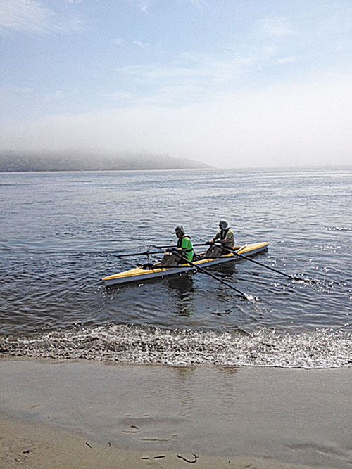 NOT SO SMOOTH SAILING: David Grody, left, and Dan Benson take off from Popham Beach on a practice run June 30. Fog set in quickly and the pair found themselves lost and swimming for their lives.