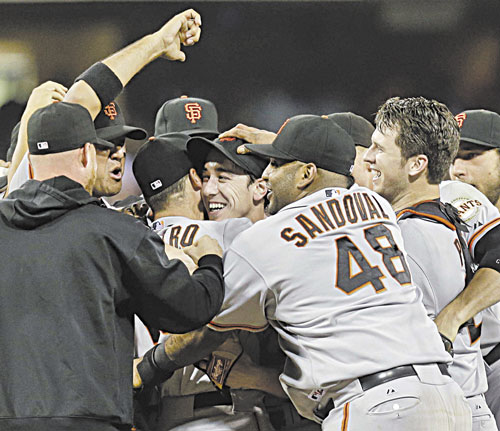 YOU DID IT: The San Francisco Giants celebrate after a no-hitter thrown by Tim Lincecum, center, against the San Diego Padres on Saturday in San Diego. The Giants won the game 9-0.