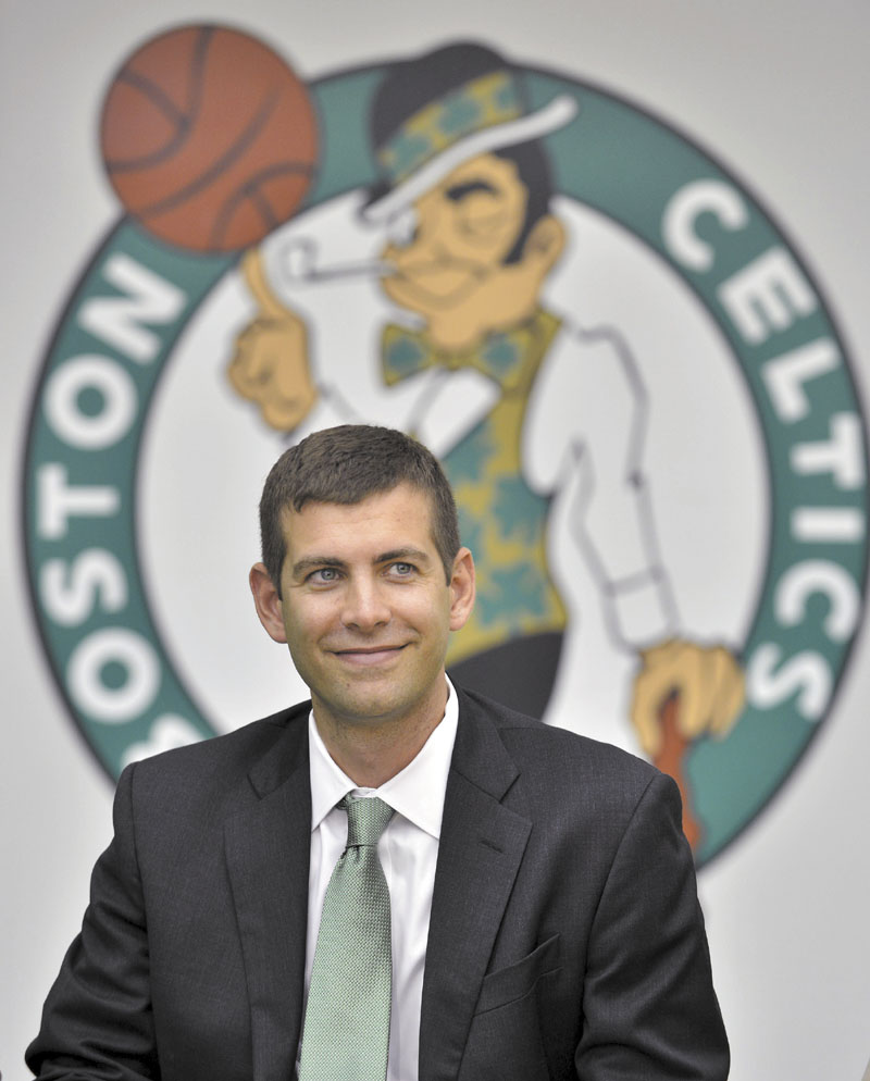 New Boston Celtics head coach Brad Stevens reacts to a question during a news conference where he was introduced Friday, July 5, 2013, at the NBA basketball team's training facility in Waltham, Mass. Stevens twice led the Butler Bulldogs to the NCAA title game. He replaces Doc Rivers, who was traded to the Los Angeles Clippers. (AP Photo/Josh Reynolds)