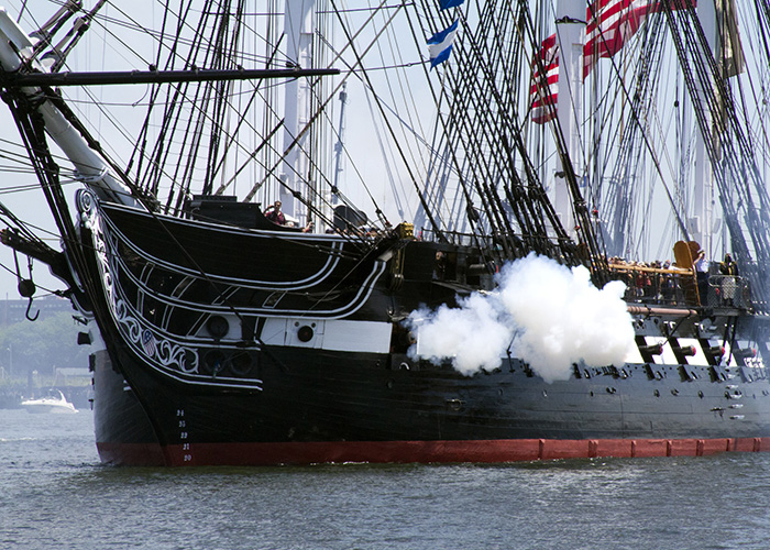 The USS Constitution fires a 21-gun salute in honor of America's 237th birthday during the ship's recent Fourth of July turnaround cruise. More than 500 guests went under way with Old Ironsides for a three-hour tour of Boston Harbor in celebration of Independence Day.