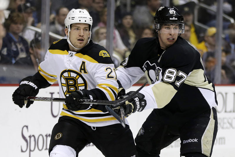 FERENCE ON THE MOVE: Pittsburgh Penguins center Sidney Crosby (87) checks Boston Bruins defenseman Andrew Ference during a game this season. The Edmonton Oilers signed Ference, a former Bruins defenseman, to a four-year deal reportedly worth $13 million.