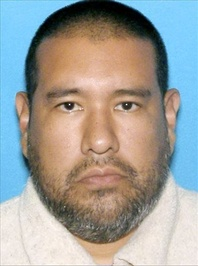 Dr. Anthony Garcia, 40, is pictured in this photo released by the Omaha police. Garcia has been linked to both the May 2013 Omaha slayings of 65-year-old Roger Brumback and 65-year-old Mary Brumback and the 2008 stabbing deaths of an 11-year-old Thomas Hunter and his family housekeeper, 57-year-old Shirlee Sherman. The slain Brumback and Hunter fired Garcia in 2001 when he was a pathology resident at Creighton Medical School.