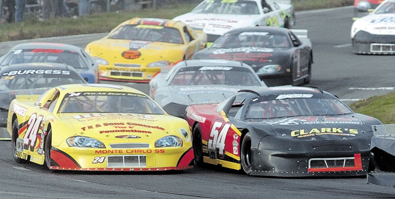 DECISIONS, DECISIONS: Johnny Clark (54) has two race cars to choose from when he runs on Sunday during the TD Bank 250 at Oxford Plains Speedway.