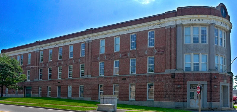 The triangular shaped, old Cony High School Flatiron building is located on the Cony Circle.