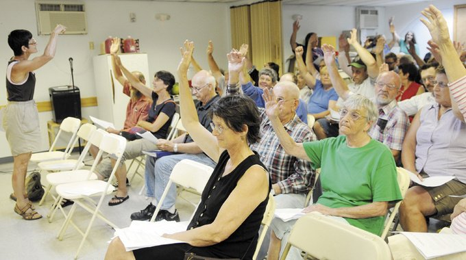Hands of Pittston residents are counted Thursday during a special town meeting to fund town operations.