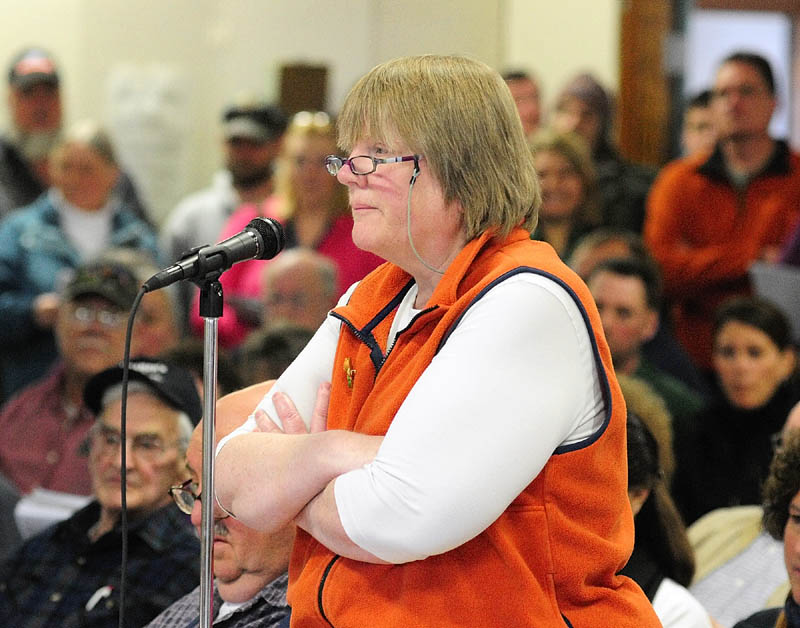 Vicki Kelley participates in the debate during the Pittston town meeting March 16.