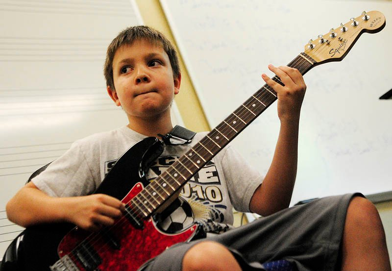 William McPherson, 10 of Oakland, plays his guitar during Rock Camp on Wednesday at the University of Maine at Augusta. There were two bands rehearsing at the camp sponsored by Maine Academy of Modern Music.