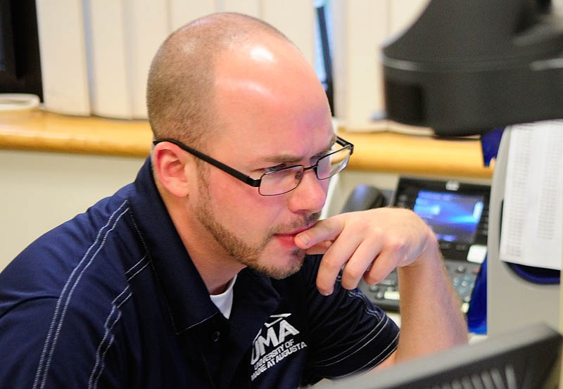 Jeremy Bouford, a 31-year-old biology major originally from Madison who now lives in Augusta, works in the advising office on Friday at the University of Maine at Augusta,