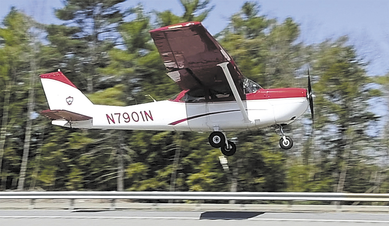 A Warden Service plane takes off from Interstate 95 in Litchfield on April 26.