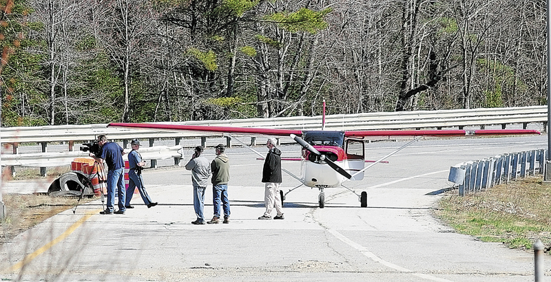 A Warden Service plane is parked on a ramp of a former highway rest stop on April 26 along Interstate 95 in Litchfield.
