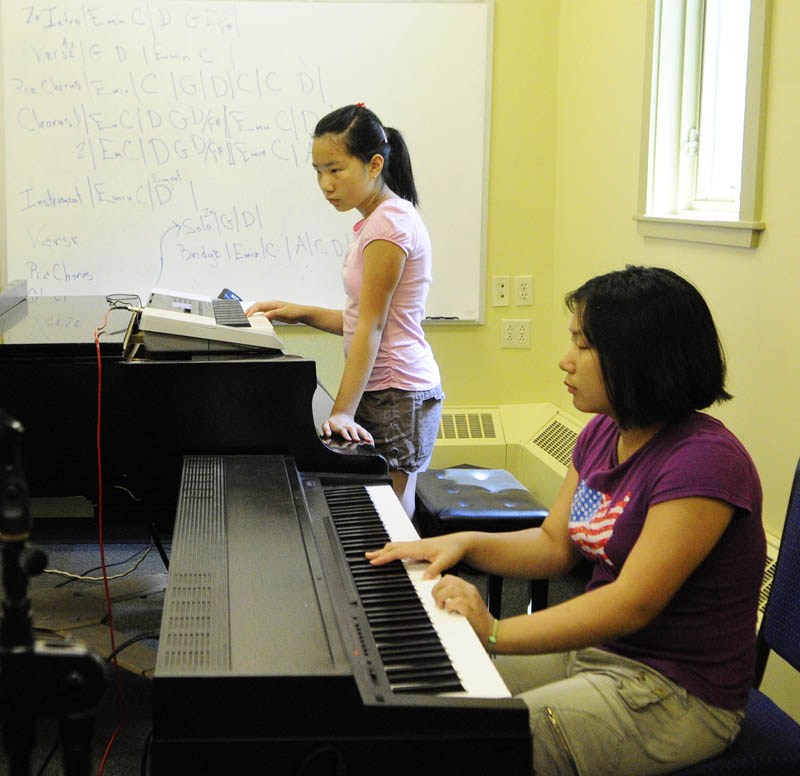 Hannah Qui, 13, left, and Erin Qui, 14, both of Gardiner, play their keyboards during Rock Camp on Wednesday at the University of Maine at Augusta.