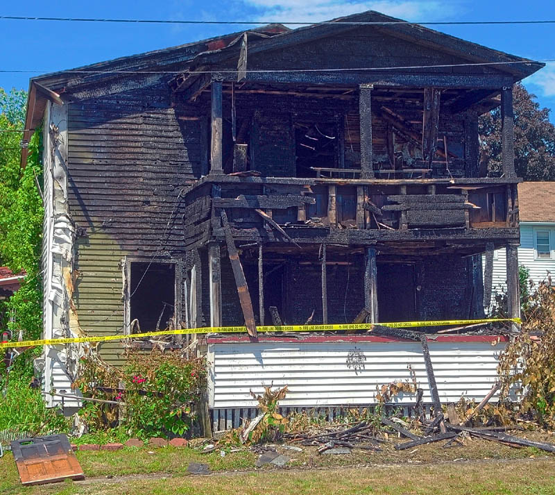 This photo taken on Friday, shows damage done by an fire the night before to a six-unit apartment building at 62 Washington Street in Augusta.