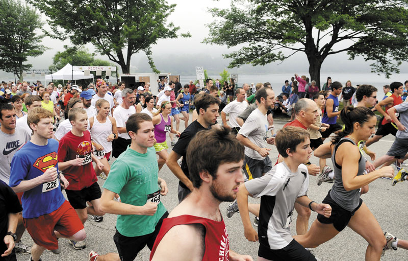 BIG RACE: Runners take off from the start line during a recent edition of the Friends on the 4th 5K in Winthrop. The race, which benefits the Cobbossee Watershed and is in its 11th year, has grown from 97 runners to 686 last summer.