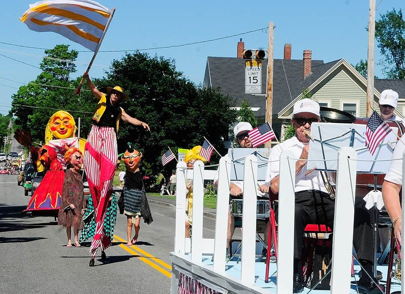 The Shoestring Theater dances to the music played by the Hallowell Community Band during the Old RIchmond Days parade on today in Richmond. In addition to the parade, today's events included a 5-kilometer race, lobster crate races, musical performances, a show by TIm Sample and fireworks.