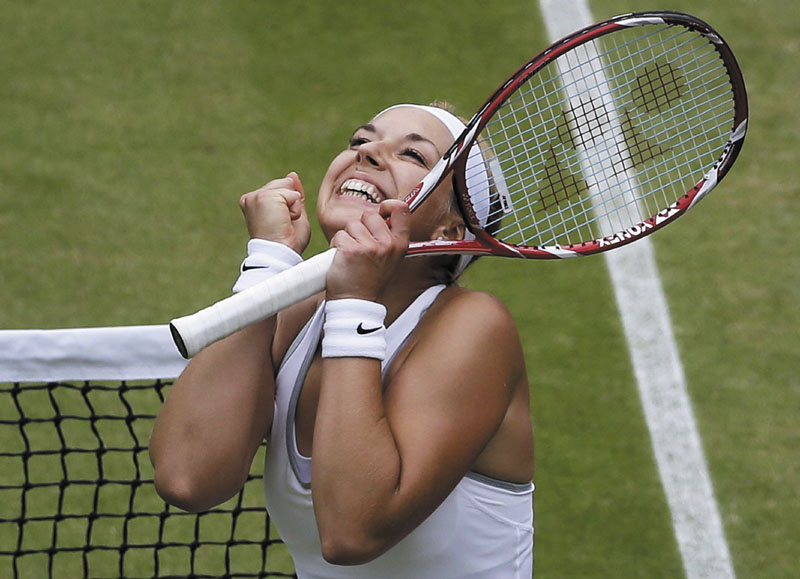 ALL SMILES: Sabine Lisicki celebrates after beating Kaia Kanepi in the quarterfinals of Wimbledon on Tuesday in Wimbledon, London. Lisicki advanced to the semifinals with a 6-3, 6-3 win.