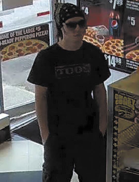 This surveillance photo from the Little Caesars restaurant on Main Street in Waterville shows the suspect in its robbery earlier today.