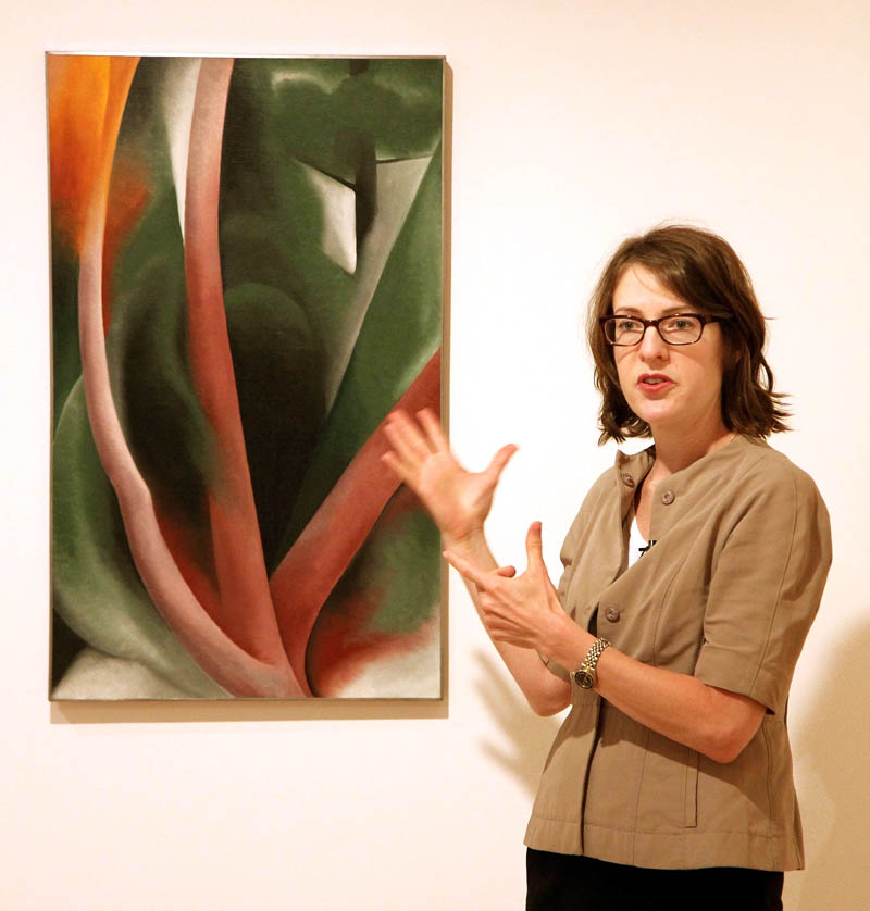 """Colby College Museum of Art Director and Chief Curator Sharon Corwin talks about a painting by Georgia O'Keefe, titled """"Birch and Pine Trees-Pink,"""" during a tour for members of the media of the Lunder Collection on Tuesday in Waterville. Corwin said the piece is one of the great works of the Lunder Collection."""