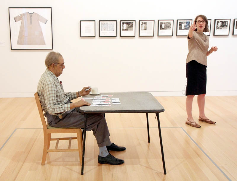 """Duane Hanson's sculpture """"Old Man Playing Solitaire,"""" foreground, is on display at the Lunder Collection, as Colby College Museum of Art Director and Chief Curator Sharon Corwin gives a tour for members of the media on Tuesday in Waterville."""