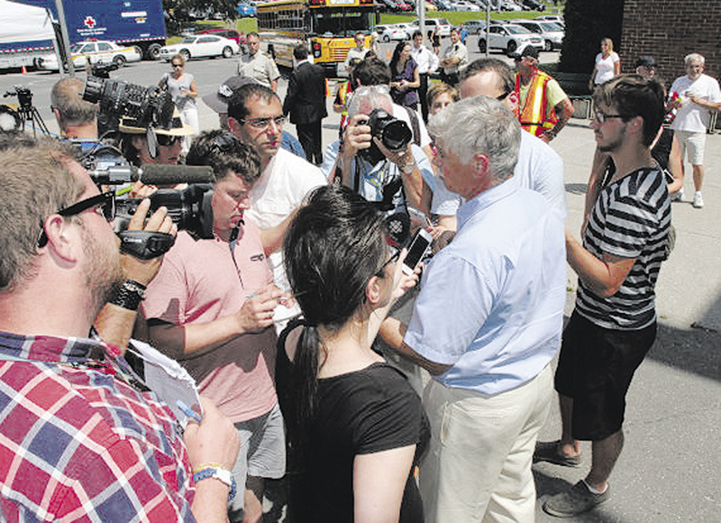 Sen. Tom Saviello at press briefing after meeting with Lac-Megantic town officials.