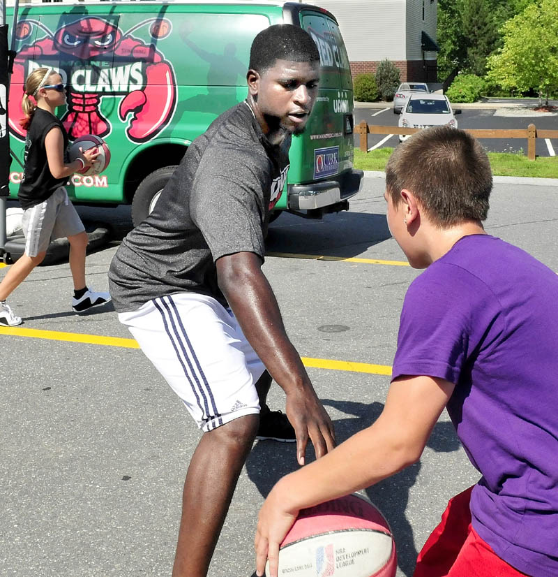 TRAVELING HOOPS: Former Red Claws player Gene Spates and Devin Lebrun play basketball Thursday when the Red Claws stopped in Waterville as part of their Summer Clinic Series.