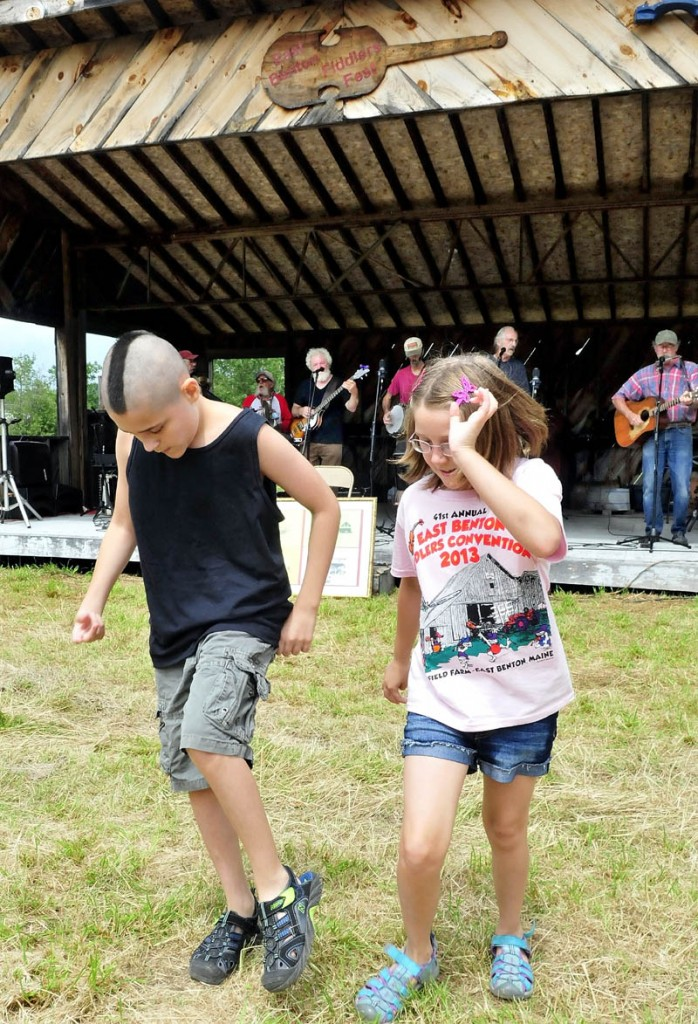 Gerry Moody and his sister, Angel, dance a jig as the Country Choir band performs during the East Benton Fiddler's Contest, Convention and Bluegrass Festival today.