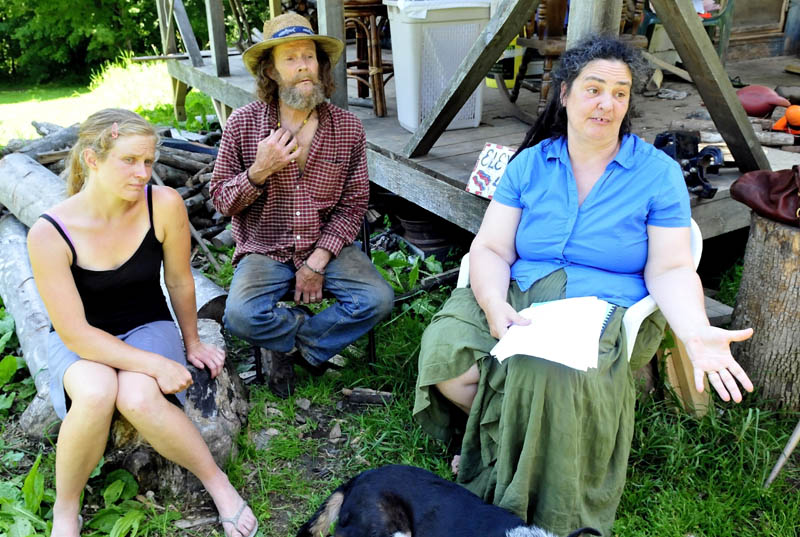 The prospect of a 195-foot cell tower being installed off Abijah Hill Road in Starks has these abutting landowners concerned both for their livelihood and health. Speaking about the situation on Monday are, from left, Elizabeth Smedberg and Harry and Cindy Brown.