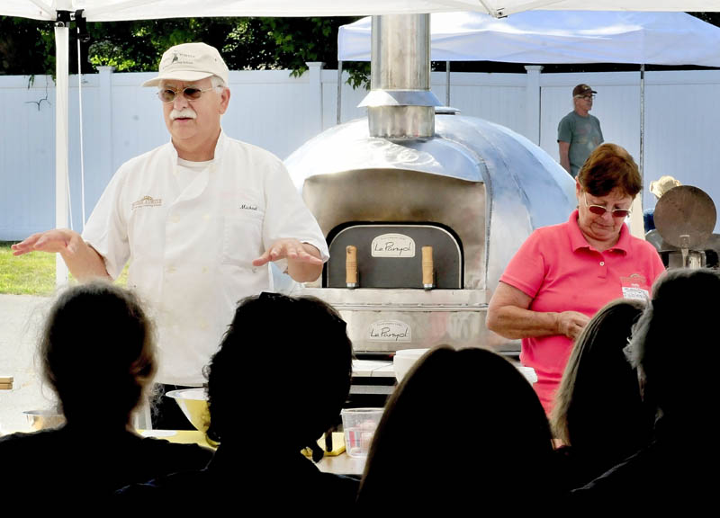Michael Jubinsky explains the process of making bread in a wood-fired oven during a workshop in the 2013 Kneading Conference in Skowhegan on Thursday. Sandy Jubinsky is at right.