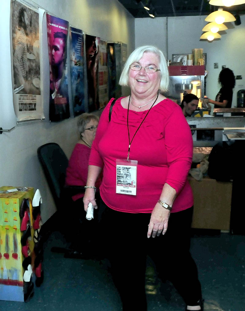 Pat Clar,k of Unity, enters the Railroad Square Cinema in Waterville to see a Maine International Film Festival movie on Sunday. Clark said MIFF has shown better movies over the years, and she estimates she has seen 512 films since the festival began 16 years ago.