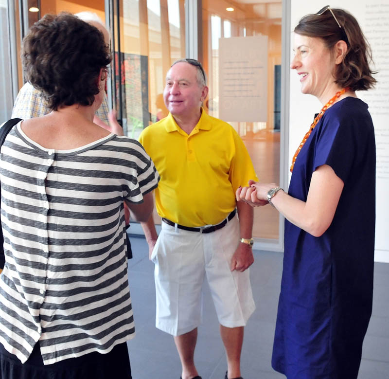 Peter Lunder, center, and Colby College Museum of Art director and curator Sharon Corwin, right, speak with guests during a tour of the expanded Alfond-Lunder Family Pavillion on Community Day on Sunday.