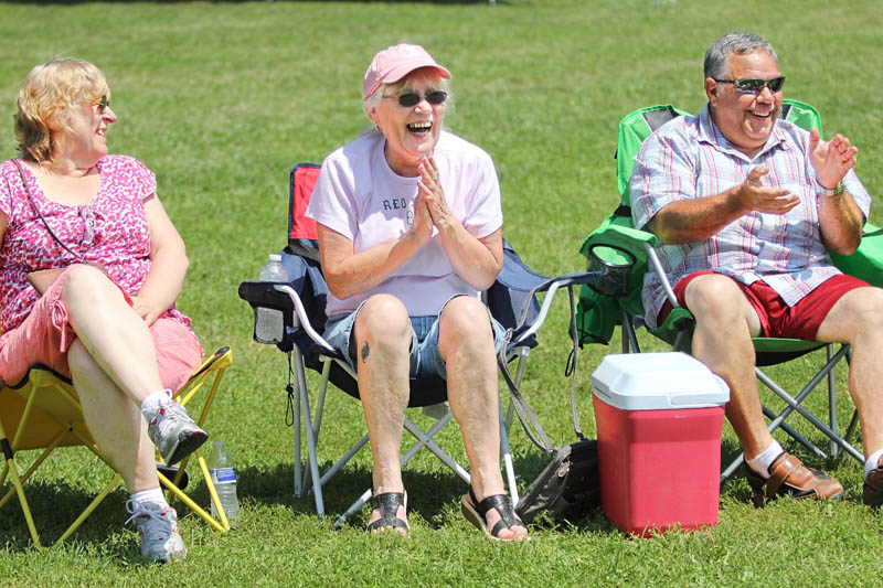 Helen MacDonald, of Norridgewock, center, reacts to a joke by Maine humorist Tim Sample during a comedy set at the 23rd Annual Winslow Family 4th of July Celebration on Wednesday. Sitting next to MacDonald is Janice Murray, of Norridgewock, left, and Wes Danforth, of Winthrop, right. Wednesday was Laughter and Dance at the Park Day.