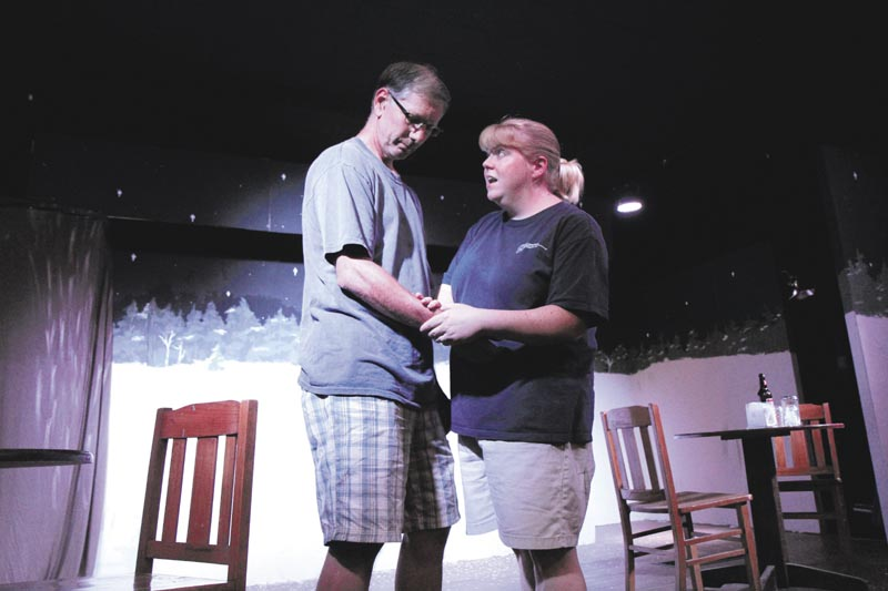 """Kim Hilton, of Wilton, playing the part of Sandrine, right, rehearses a scene of """"Almost, Maine,"""" with Jimmy Cook of Waterville, playing the part of Jimmy, at the Sparrow's Nest Community Theater in Industry recently."""