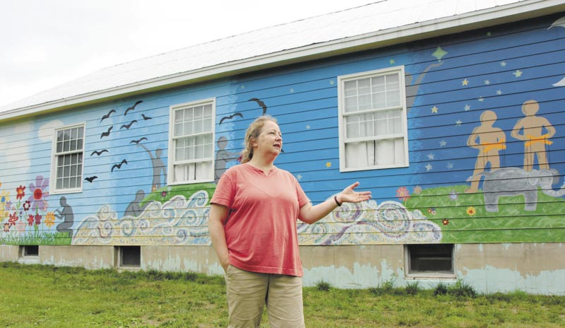 Diane Leeman, a director at the Sparrow's Nest Community Theater in Industry, talks about a mural painted on the outside of the former church turned theater. Leeman said the mural was painted in 2011 by teenagers from Red Clay Creek Presbyterian Church of Wilmington, Del.