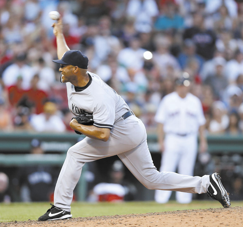 ANOTHER SAVE FOR MO: New York Yankees' closer Mariano Rivera delivers a pitch in the ninth inning of the Yankees' 5-2 win over the Boston Red Sox on Saturday at Fenway Park in Boston.