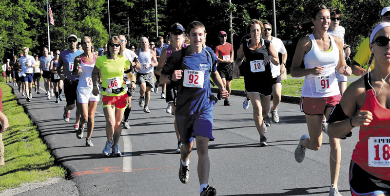 THEY'RE OFF: More than 150 runners take off at the start of the third annual PFBF CPA's Half Marathon and 5K Run/Walk last year. The fourth edition of the race will be held Sunday, July 14.