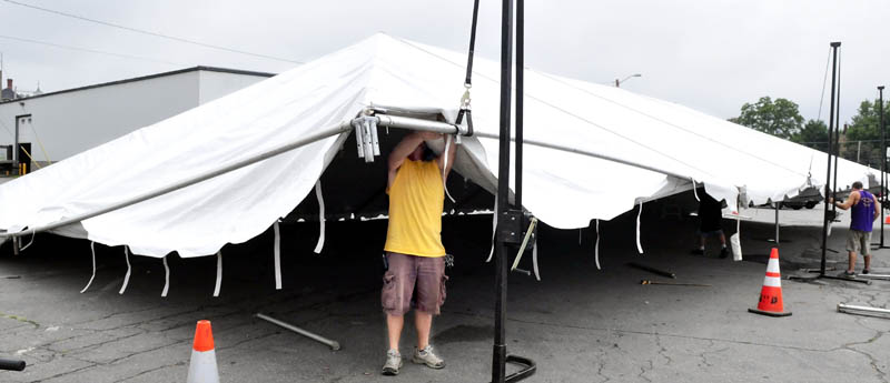 Jeff Humphrey of the Are You Ready To Party company today erects a tent beside the Skowhegan Chamber of Commerce, for the six-day River Fest event that begins Tuesday.