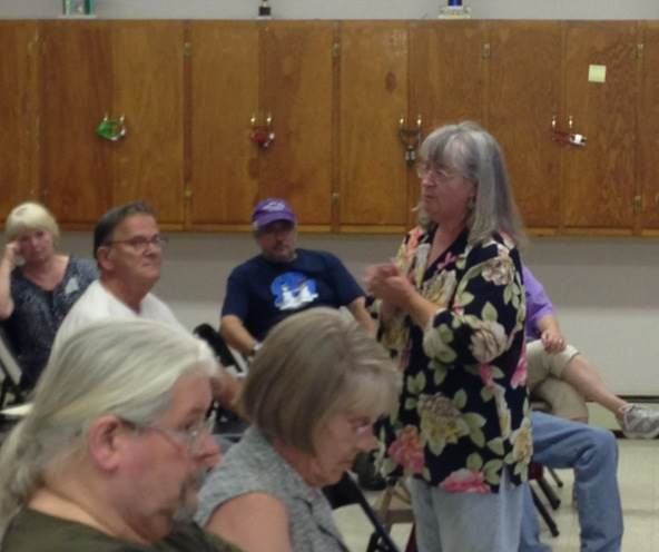 Gail Kelley speaks at the Clinton police department public hearing tonight.