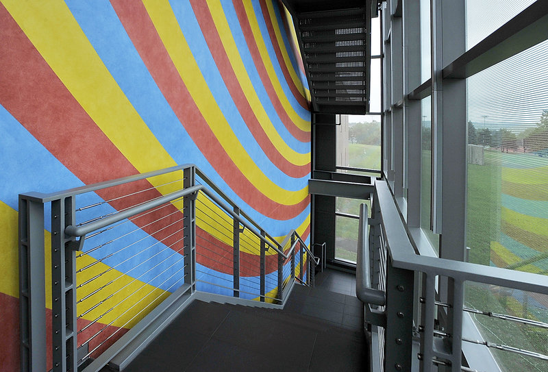 """The three-story wall painting, visible outside one of the glass walls of the Alfond-Lunder Family Pavilion at Colby College Museum of Art in Waterville, met with approval from philanthropist Peter Lunder. """"They'll know there's a museum there now,"""" the art collector said. """"The (Sol) LeWitt (artwork) is drop-dead gorgeous.""""'"""