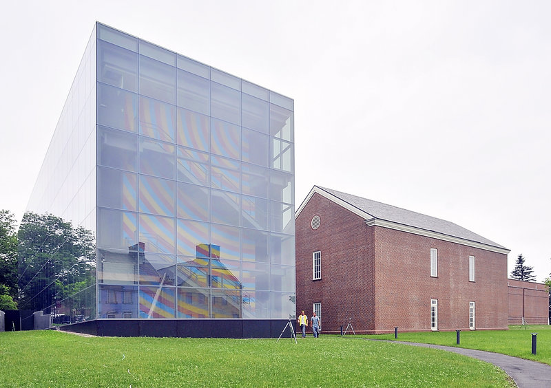 Colby College's $15 million Alfond-Lunder Family Pavilion, left, adds a sparkling new minimalist wing to the museum and brings contrast to a campus rich in classic red-brick structures. Inside, a three-story wall painting by artist Sol LeWitt provides a vibrant splash of color amid the glass- and metal-encased building.