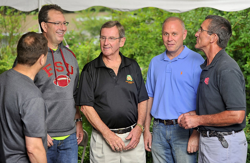 Former Cumberland resident Peter Bickmore, second from right, spends time with friends during a gathering in Yarmouth. From left are Sgt. Michael Edes of the Maine State Police; David Goodman, with the Tampa (Fla.) police; John Kyle, owner of Pat's Pizza in Yarmouth; and Lt. Milt Calder of the town of Cumberland police.