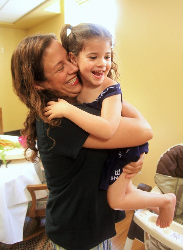 Shelly Fasano shares a hug with her daughter, Gina Carbone, 3, at McAuley Residence in Portland. Fasano is now in the last months of her two-year treatment program.
