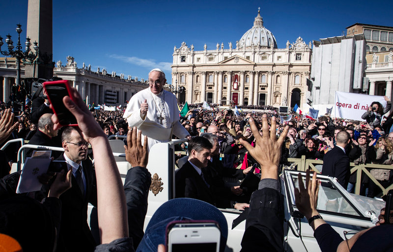 Pope Francis is driven through the crowd in St. Peter's Square for his inauguration Mass in March. The pope is forgoing the bulletproof popemobile for his trip to Brazil.