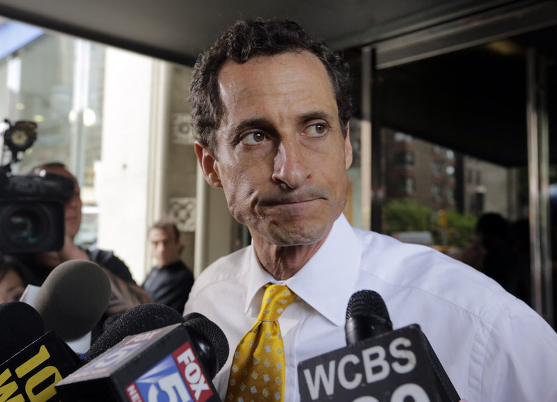 Anthony Weiner leaves his New York apartment building Wednesday. Revelations of sexting destroyed his congressional career two years ago.