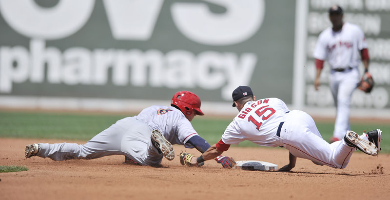 Sea Dog second baseman Derrik Gibson makes a diving attempt to tag Harrisburg's Ricky Hague during the Futures at Fenway game Saturday in Boston. Portland beat Harrisburg 5-2.