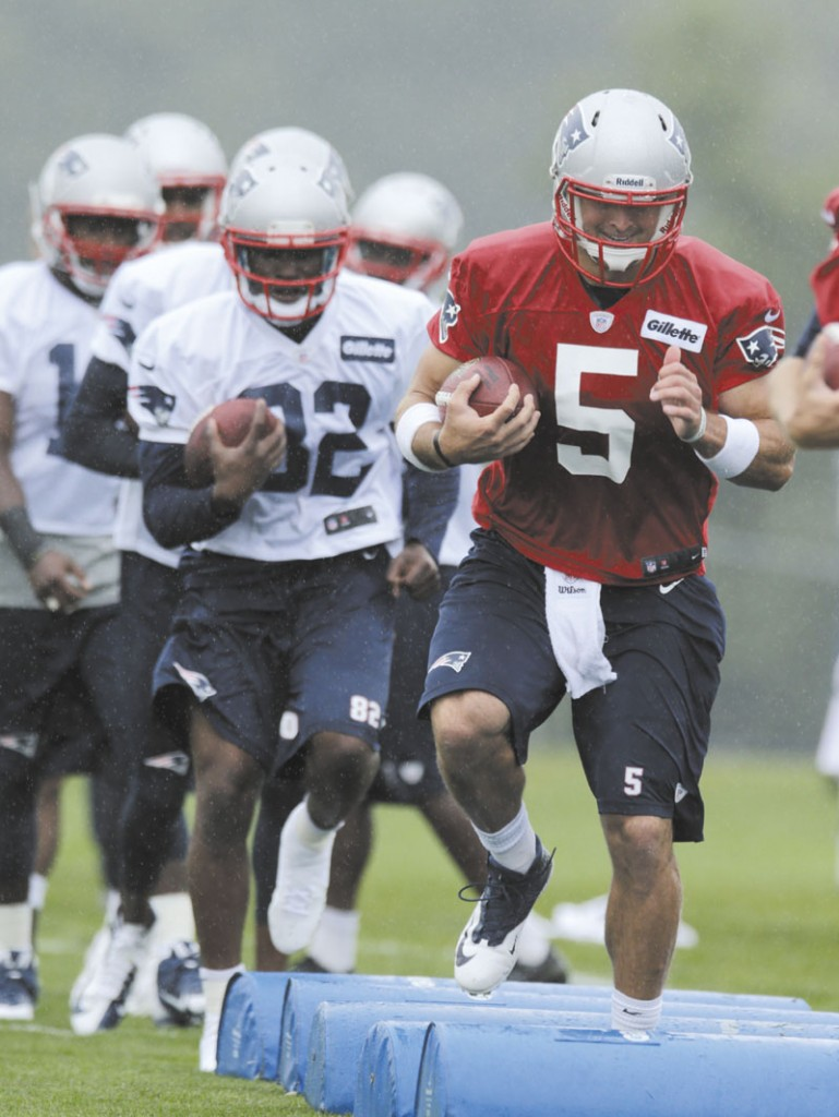 PUTTING IN WORK: New England Patriots quarterback Tim Tebow works out during training camp Friday in Foxborough, Mass. Tebow signed with the Patriots on June 11 to compete for the backup quarterback job.